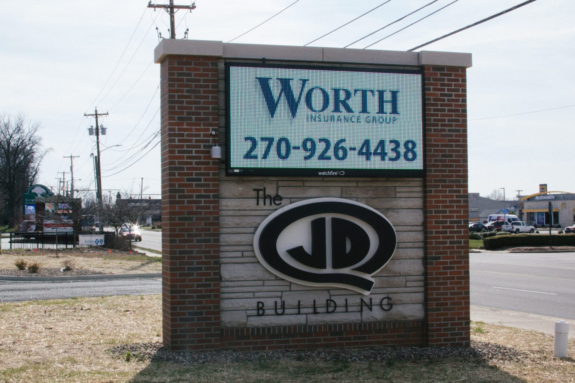 Worth Insurance banner on the lcd screen for the JDQ Building