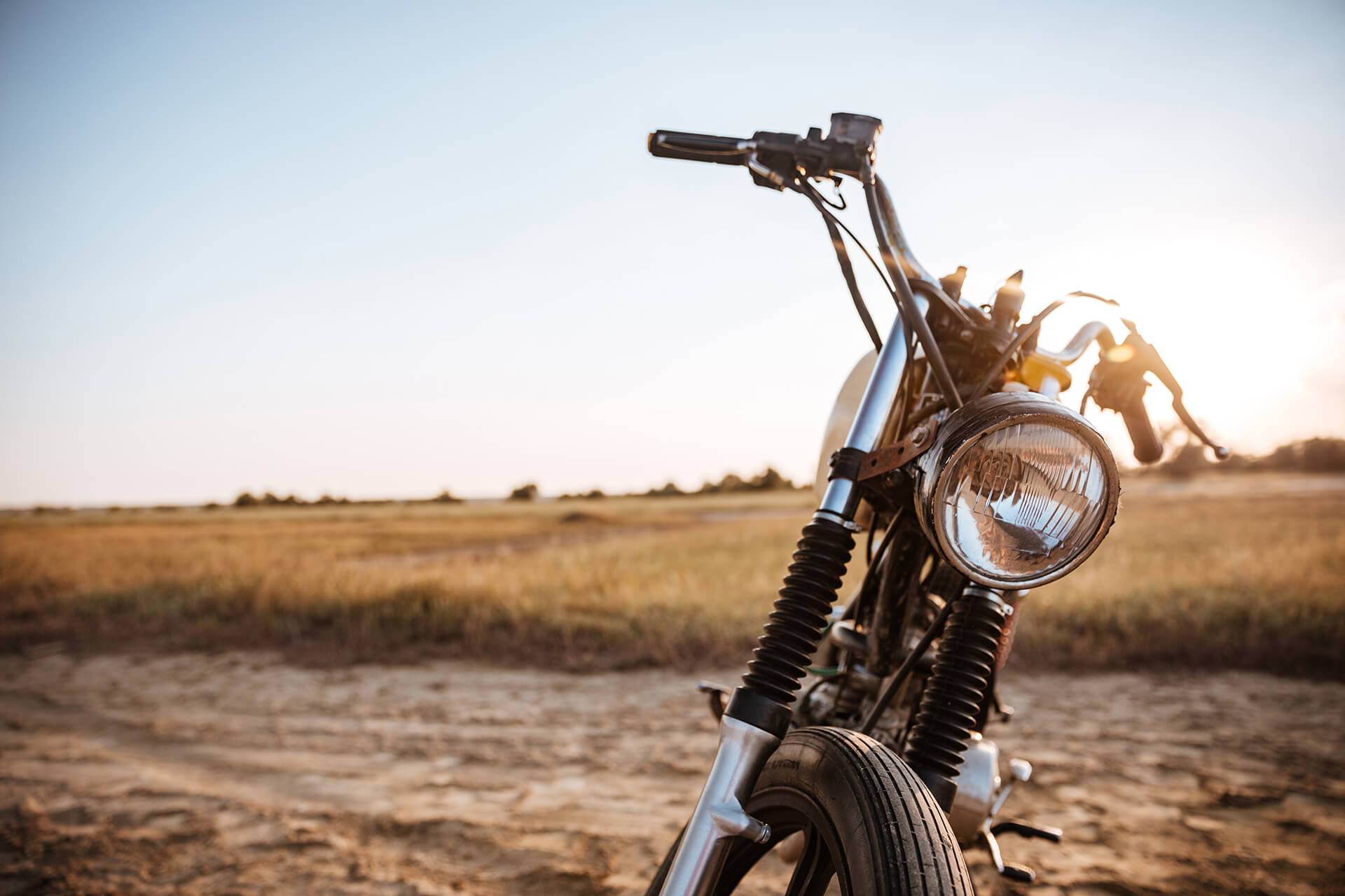 Picture of a motorcycle in a field. Represents motorcycle insurance